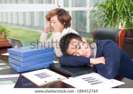 Two depressed business people, sleeping at your desk