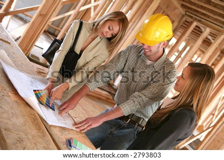 Two designers and a home builder discussing color plans