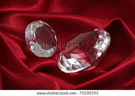 Two diamonds over a red silk