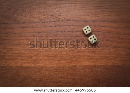 two dice on a wooden table value of four Stock photo ©