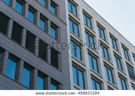 office facades. Two Different Office Facades In A Row At Low Angle View Q