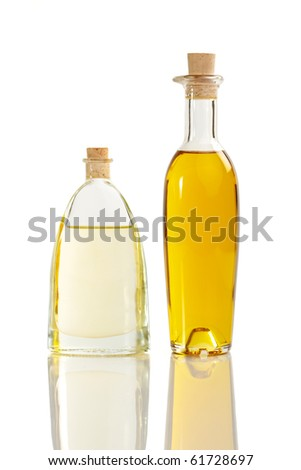 Two different oil bottles with two sorts of oil