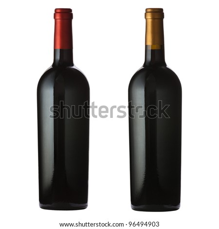 Two different red wine bottles isolated on white with clipping path.