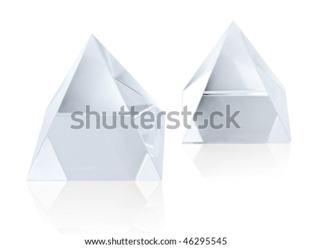 Two different size clear transparent crystal pyramids on white