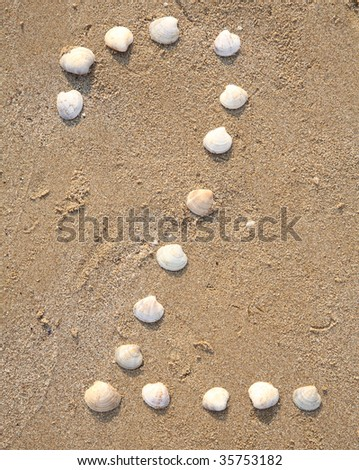 two digit symbol from shells in a sand