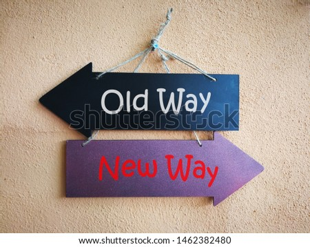 Two direction signs, old way or new way