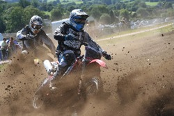 Two Dirt Bikes Battle a Corner