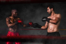 two diversity people african american boxer and caucasian boxer challenge to fight in ring