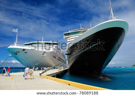 Two docked cruise ships - stock photo