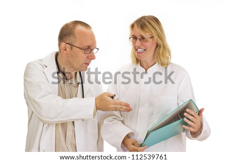 Two doctors are discussing about some documents