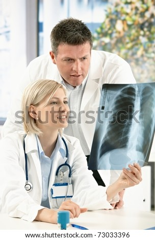 Two doctors having medical consultation of x-ray image.?