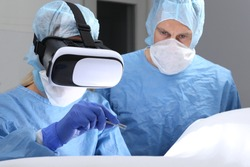 Two Doctors in Operating room surgery with virtual reality