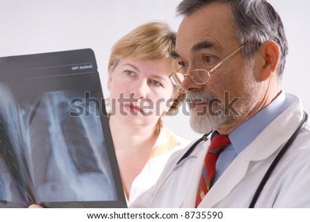Two doctors looking at an xray