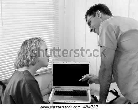 Two doctors; nurses or medical students consulting; black and white