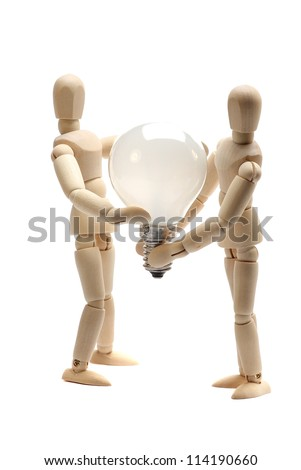 two dolls holding a light bulb