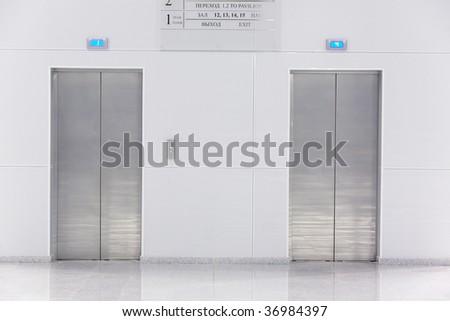 Two doors of elevators in modern business building
