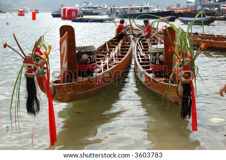 Two dragon boats ready to race