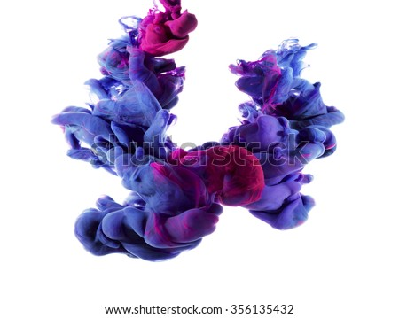 Two drops of color merged under water create colorful organic abstract form and shapes with detailed structures. Blue and magenta ink color swirl.