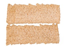 Two dry rectangular flat dietary rye-wheat crispbreads on a white background, top view close-up. Background, texture