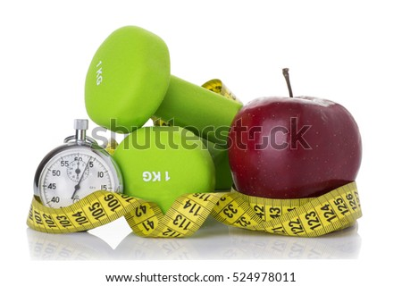 Two dumbbells, red apple, measuring tape isolated on white background. Diet concept. Stock photo ©