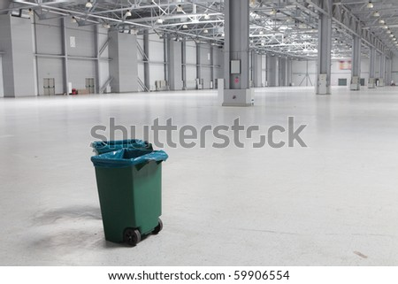 Two dustbins in large modern storehouse