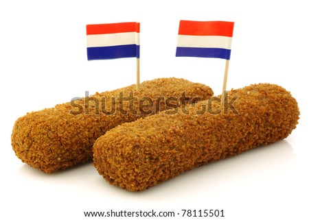 "Two Dutch snacks called ""kroket"" with Dutch flag toothpicks on a white background"