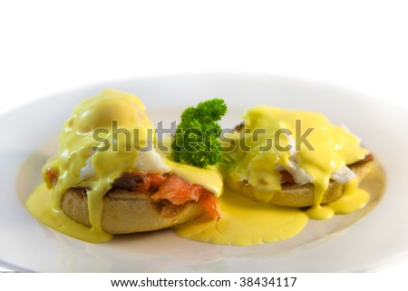 Two egg benedict on place with smoked salmon