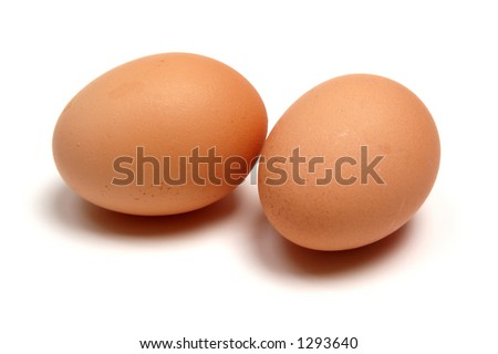 Two eggs, isolated on a white background. - stock photo