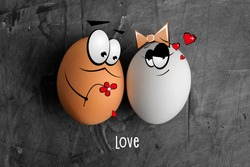 Two eggs of white and brown color with cartoon faces on a dark background. The concept of creating a family, love, a first date. Copy space