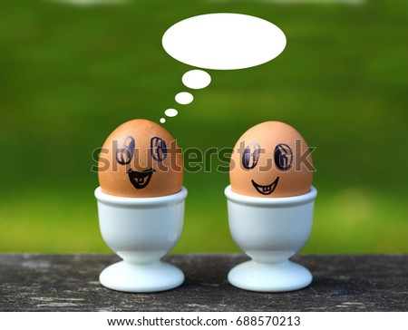 two eggs with faces. Dialogue bubbles.  #688570213