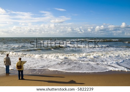 Two elder people watching over the sea
