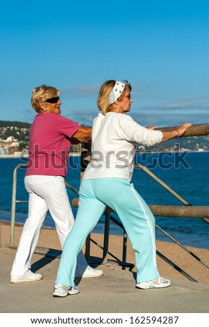 Two elderly women getting ready for jogging outdoors. - stock photo