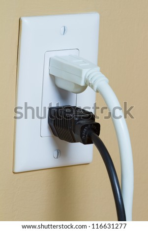 Two Electric black and white cable in Electrical Outlet on the Wall. Power 110v - stock photo