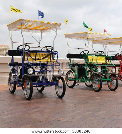 Two electric carts cars, for tourists to sigh tsee in Saint Petersburg, Florida at the pier using green energy.