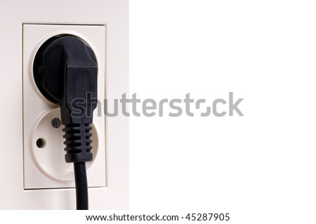 Two electric outlets on black white wall, connect cable