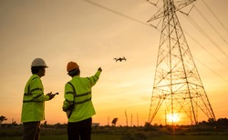 Two electrical engineers used drones to observe the planning work, producing electric power at high voltage electrodes