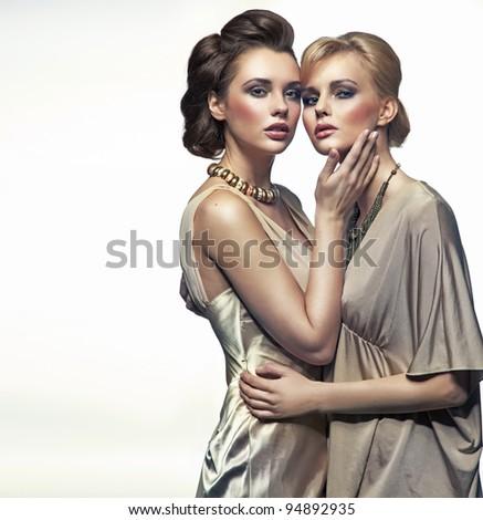 Two elegance ladies hugging
