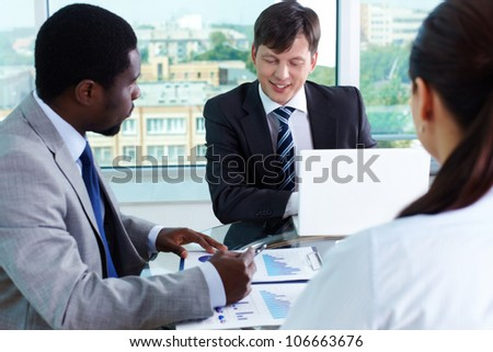 Two elegant businessmen communicating at meeting - stock photo