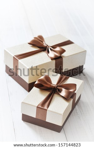 two elegant gift boxes on a light background