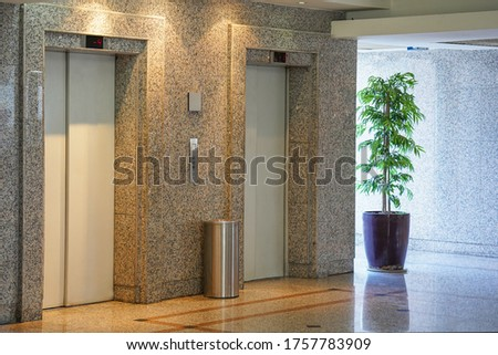 Two elevator doors in office building. Wide angle view of modern elevators with doors. Elevators in the modern lobby house or hotel.