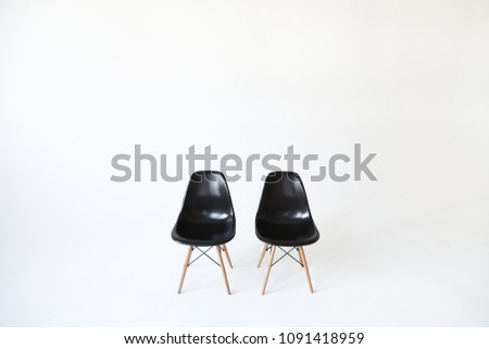 Two empty (blank, vacant, hollow) black chairs isolated over white background. Space for text. Vacant chairs. The concept of selection and casting.  #1091418959