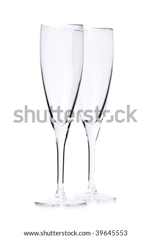 Two empty champagne flutes isolated on white background