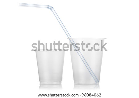 Two empty disposable plastic cup and straw isolated on white background