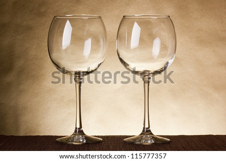 Two empty glasses in the old style.
