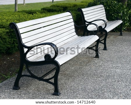 two empty park benches