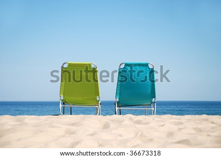 Two empty sunbeds on a gorgeous sandy beach (landscape)