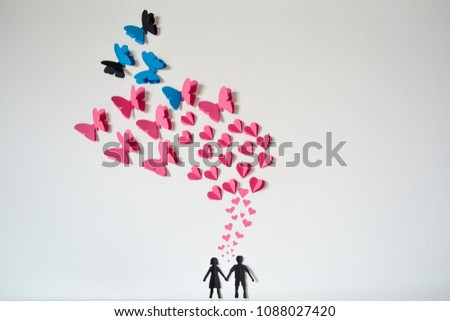 Two enamored paper silhouettes with colorful hearts #1088027420