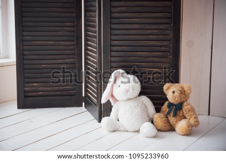 Two enamored teddy toys bear and bunny sitting next to. #1095233960