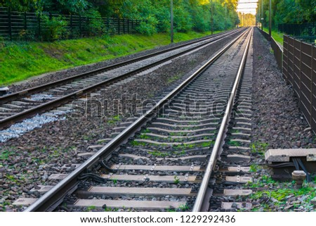 two endlessly long train railroads with the tracks vanishing in the distance horizon amazing transportation or traveling background #1229292436