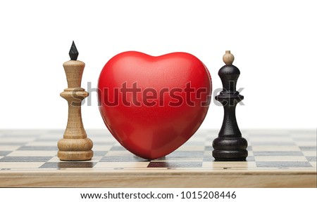 Two enemies fall in love. There is the red heart between white chess queen and black king on the chess board. Isolated. Forbidden love.